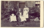 Three Edwardian Maids takingtea