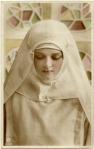 Gladys Cooper as aNun