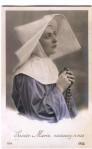 1910 Nun holding arosary