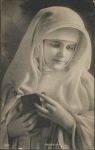 1920's Romantice image of a Nun with aBible