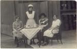 An Edwardian Maid serves afternoontea