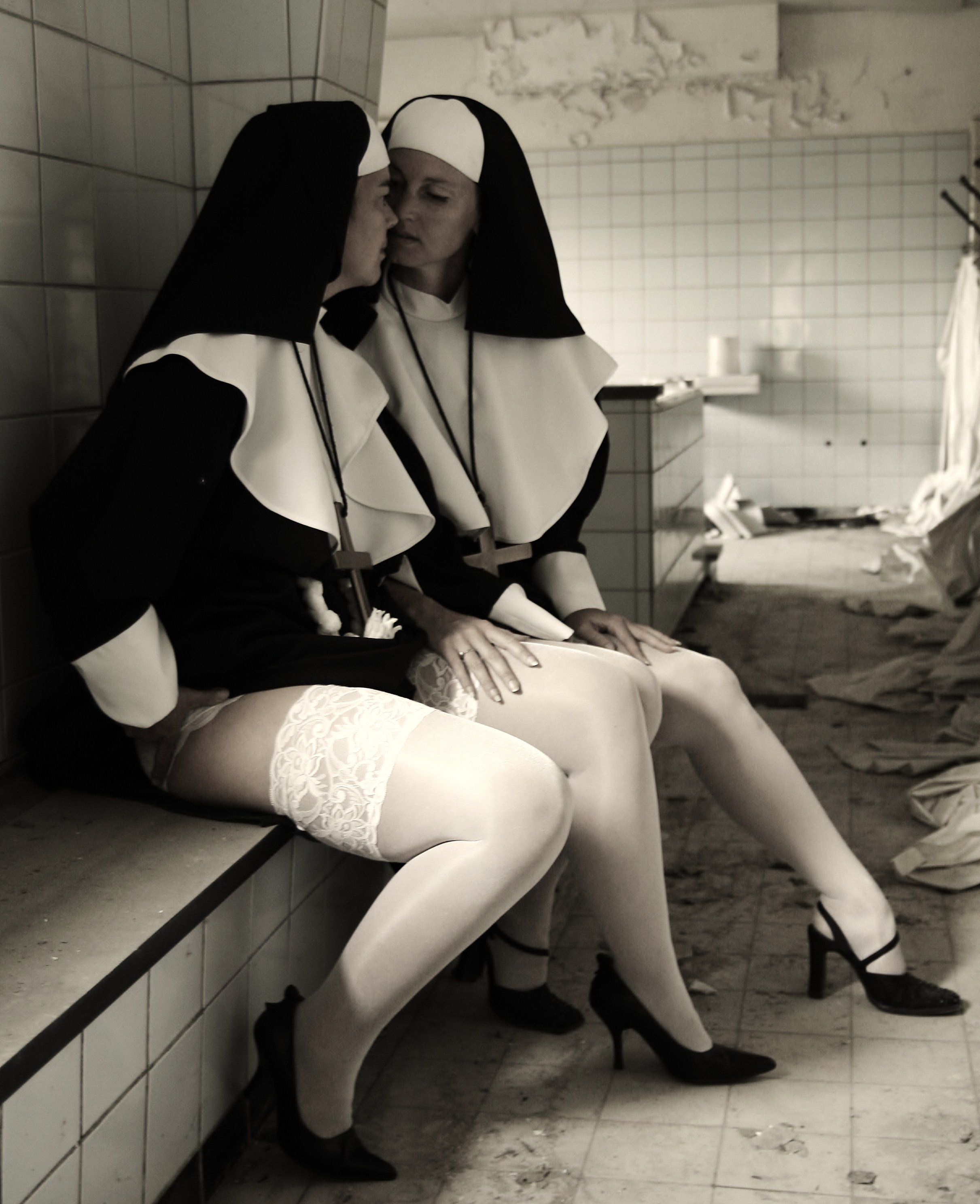 Nun nude drinking with priests apologise, but