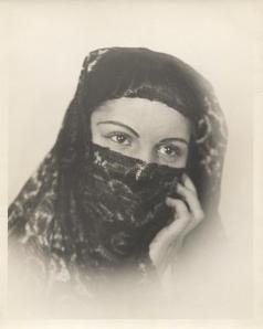 Veiled woman c1940