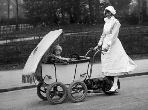 An English nanny driving a motorized pram 1922
