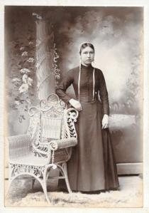 A glum Amish woman