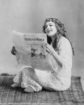 Mary Pickford reading a newspaper with 'Votes for Women' on the cover(1929)