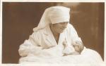 Nurse and newborn c1900a